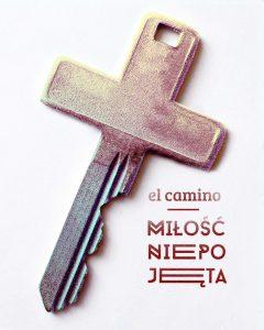 """Opis zdjęcia: Krzyż w kształcie klucza i napis """" El camino (po hiszpańsku - droga) - Miłość Niepojęta""""."""